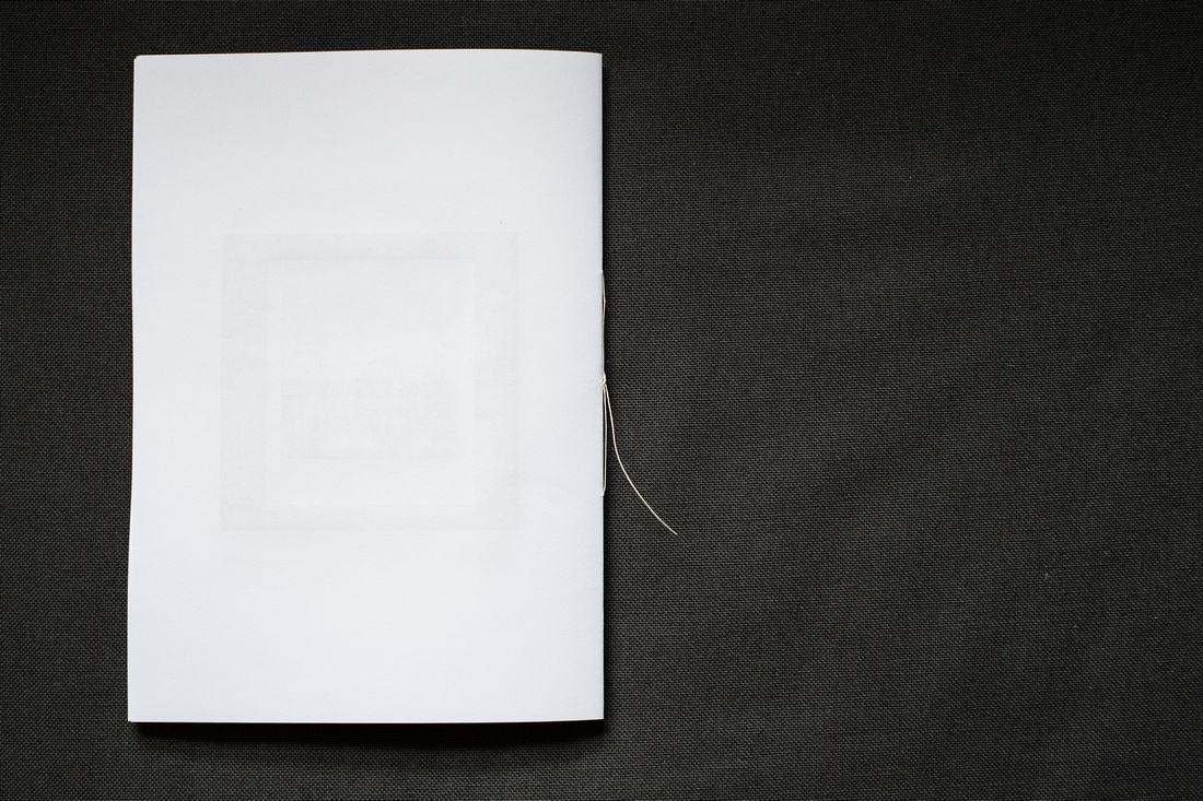 A Zine About March 2021, photograph shows the printed zine photographed on a dark grey background.