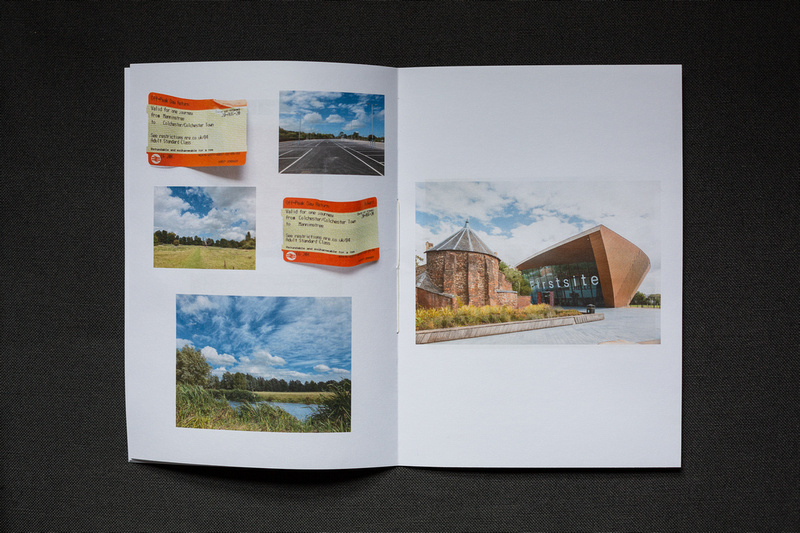 Photograph of a home made photozine on dark grey fabric. Left page shows train tickets and photographs of an empty carpark and field scenes from a walk. On the right side an exterior photograph of Firstsite gallery.
