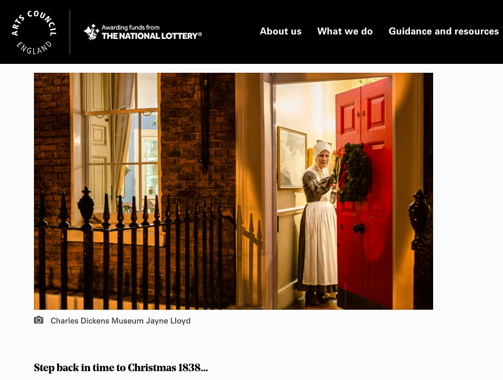 Screenshot of the Arts Council England showing an actor in role as a housemaid looking out through an open front door at the Charles Dickens Museum.