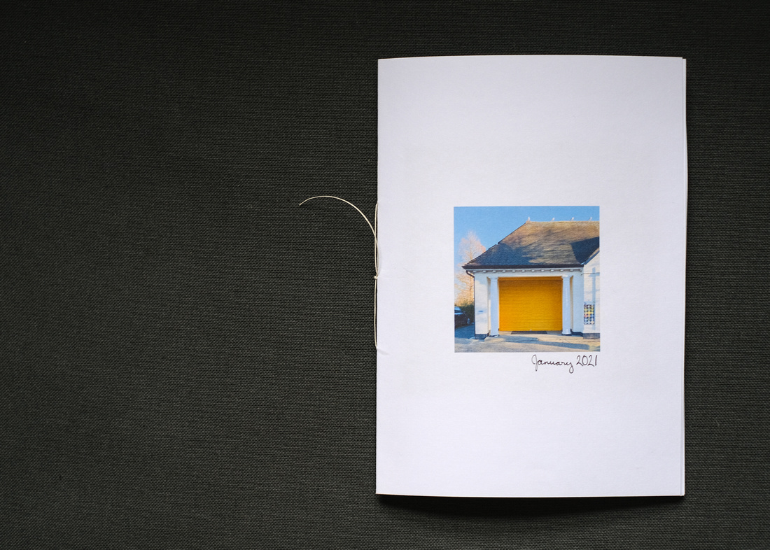 Photograph of a page from A Zine About January 2021, on a dark grey fabric background.