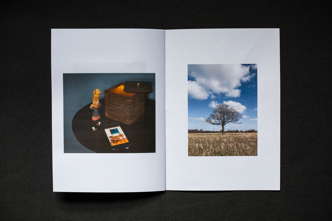 A Zine About February 2021, photograph shows the printed zine photographed on a dark grey background.