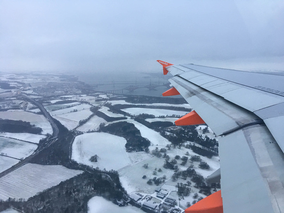 View from the plane, snow covered fields and an EasyJet wing.